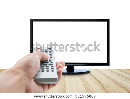 Hand holding remote control  TV and wood floor on white background