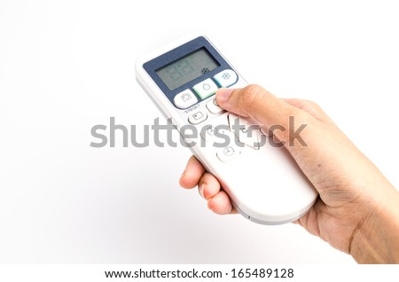 Hand holding remote on isolated white background