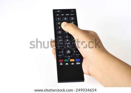 Hand Holding Remote on White Background, Selective Focus - stock photo