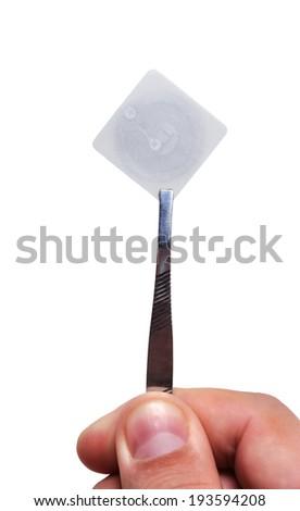 hand holding  rfid tags on tweezers - stock photo