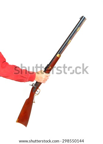 Hand holding rifle on white background. Gun control or home defense concept. - stock photo