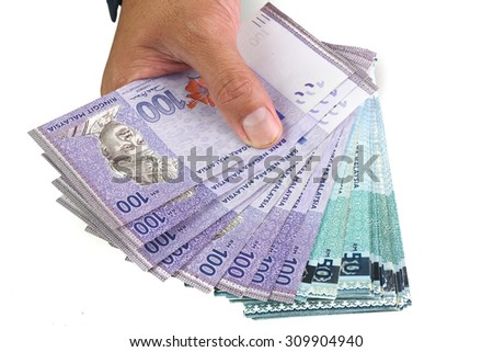 Hand Holding Ringgit Malaysia 100 and 50