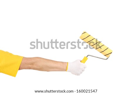 Hand holding roller. Isolated on a white background.