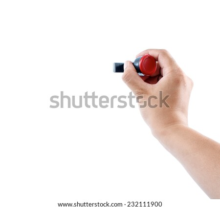 hand holding rubber stamp on white background - stock photo