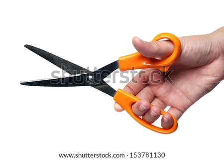hand holding scissors isolated on white background.