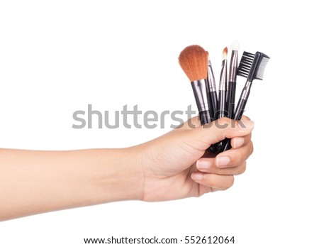 hand holding set of Make up brush isolated on white background