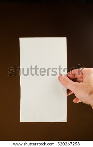 hand holding sheet of paper