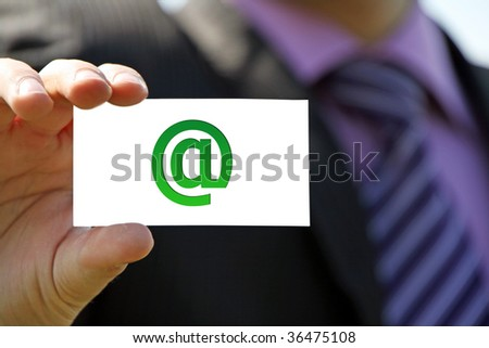 Hand holding sign - stock photo