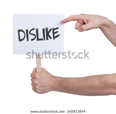 Hand holding sign, isolated on white - Dislike - stock photo