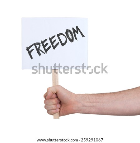 Hand holding sign, isolated on white - Freedom