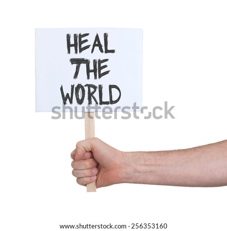 Hand holding sign, isolated on white - Heal the world - stock photo