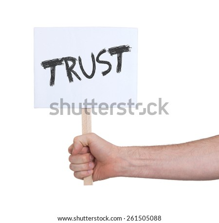 Hand holding sign, isolated on white - Trust - stock photo
