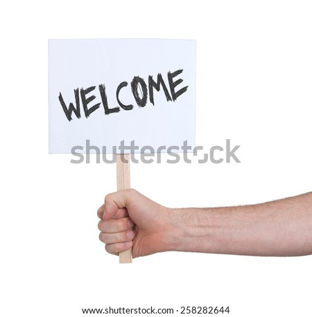 Hand holding sign, isolated on white - Welcome