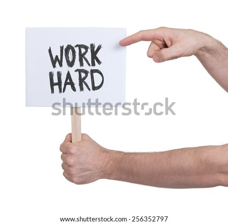 Hand holding sign, isolated on white - Work hard