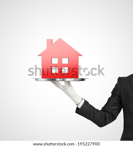 hand holding silver plate with red house icon - stock photo