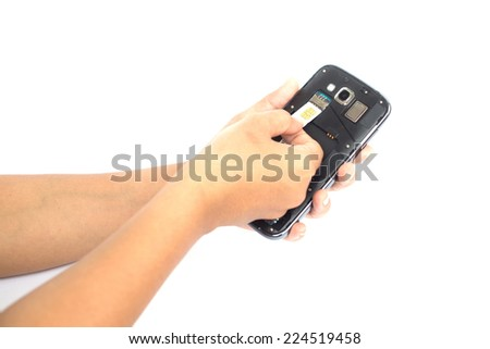 Hand holding sim card and put into smartphone isolated on white background