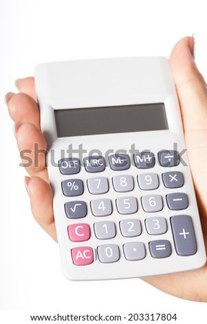 Hand holding simple calculator on isolated background - stock photo