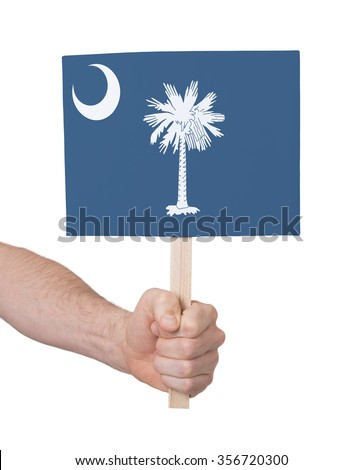 Hand holding small card, isolated on white - Flag of Oklahoma - stock photo