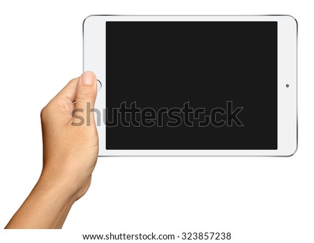 Hand holding Small White Tablet Computer on white background - stock photo