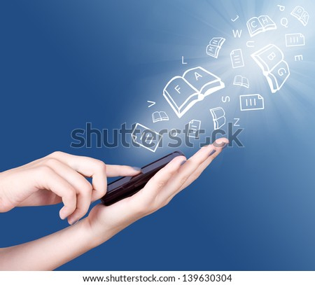 Hand holding smart mobile phone and open books,sheets and letters flying away, Education concept - stock photo
