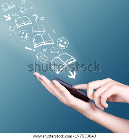 Hand holding smart mobile phone and open books,sheets and letters flying away, Education concept