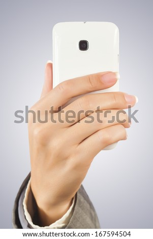 Hand holding smart phone with - stock photo