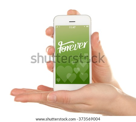 Hand holding smart phone with romantic screensaver isolated on white - stock photo