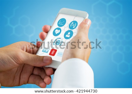 hand holding smartphone against chemical structure in blue and white