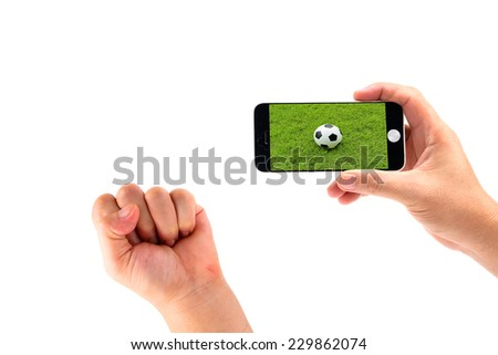 Hand holding Smartphone for lookig live football isolated on white - stock photo