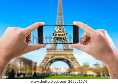 Hand holding Smartphone in Paris, France - stock photo