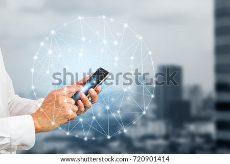 Hand holding smartphone with digital connections on blurred city background, communication technology concept