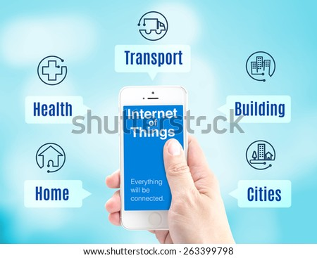 Hand holding smartphone with Internet of things (IoT) word and application icon on blur background, Digital Marketing concept - stock photo