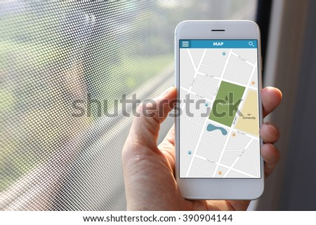 Hand holding smartphone with map application - stock photo