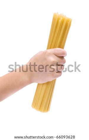 Hand holding spaghetti - stock photo