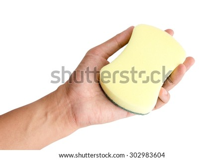 Hand holding sponge on isolated white background. - stock photo