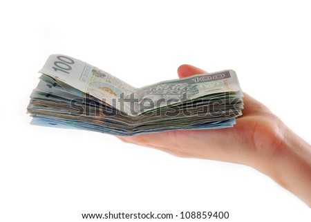 hand holding stack of polish banknotes isolated on white - stock photo