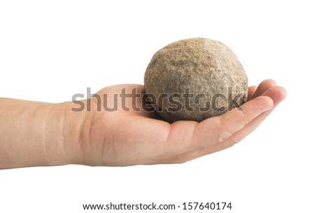 Hand holding stone ball. Piece of stone - stock photo