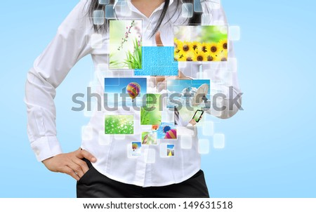 hand holding streaming images virtual buttons - stock photo