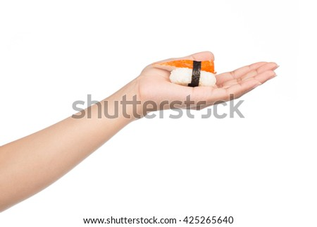 hand holding Sushi roll isolated on white background