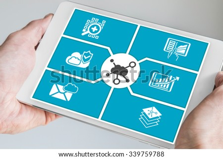 Hand holding tablet. Concept of cloud computing dashboard for mobile devices. - stock photo