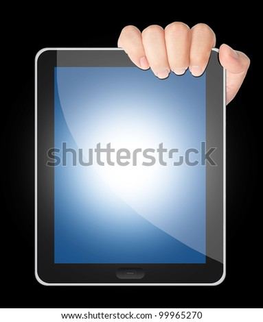 Hand holding tablet PC with blank blue screen isolated on black background - stock photo