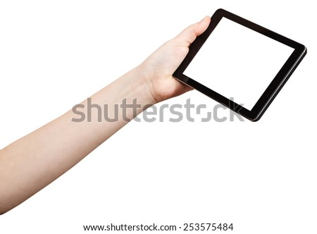 hand holding tablet-pc with cutout screen isolated on white background - stock photo
