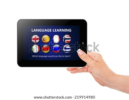 hand holding tablet with language learning page over white background