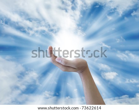 Hand holding th sun - stock photo