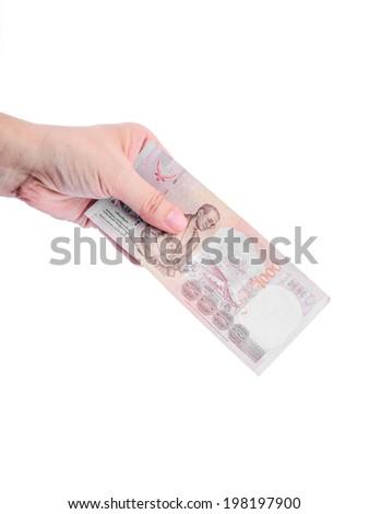 Hand holding Thai money isolated on white. - stock photo