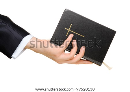 Hand holding the Bible. Isolated on white - stock photo