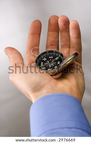 Hand holding the compass close up shoot - stock photo