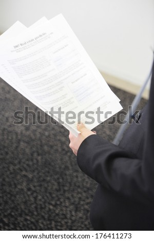 Hand holding the document