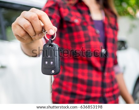 hand holding the remote control car alarm systems