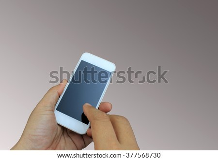 hand holding the smartphone on background